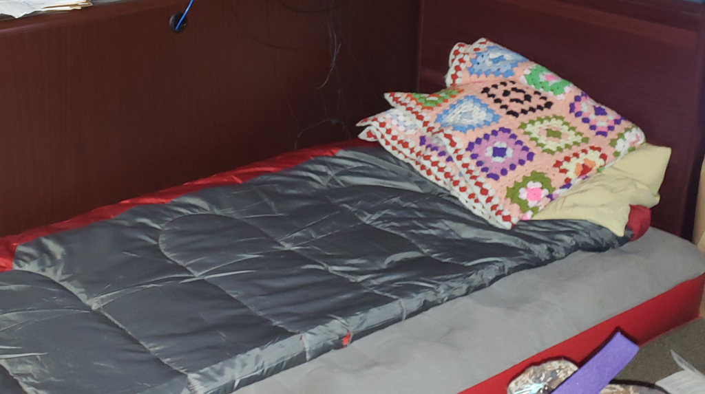 An inflatable bed with a sleeping bag.