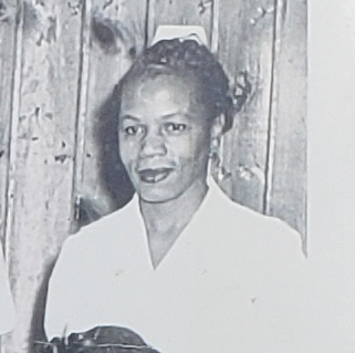 A black and white photo of a nurse