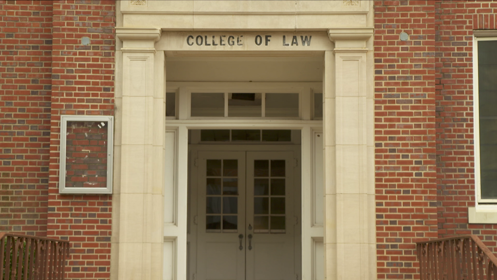 A close up of a brick building with College of Law etched above it.