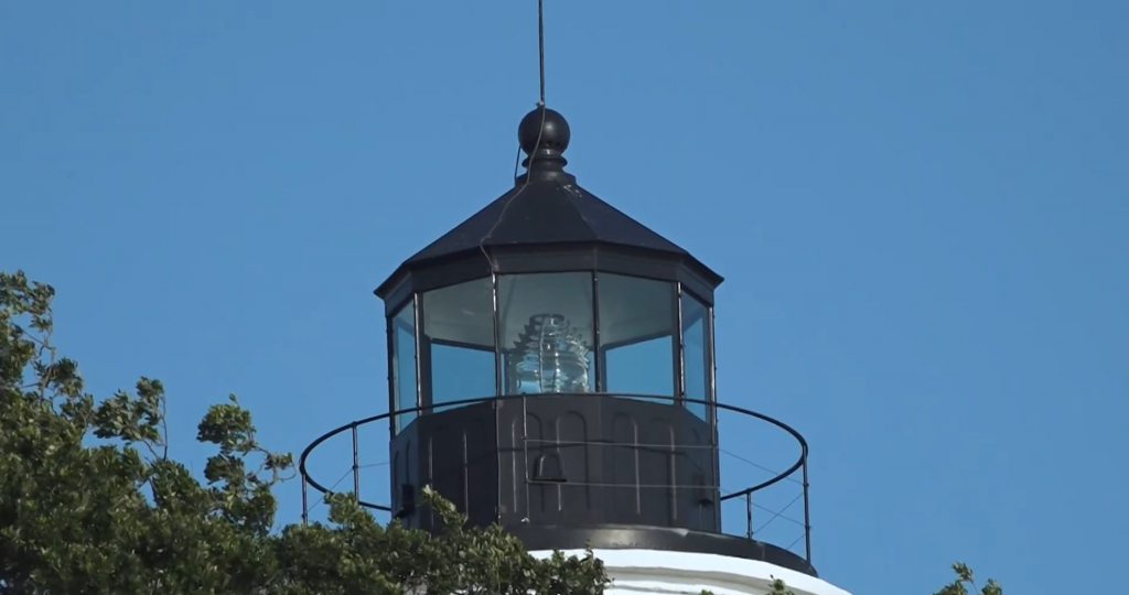A Fresnel lens is seen in the lamp room of a lighthouse.