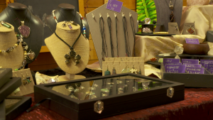 necklaces and other jewelry displayed on a table and in a box