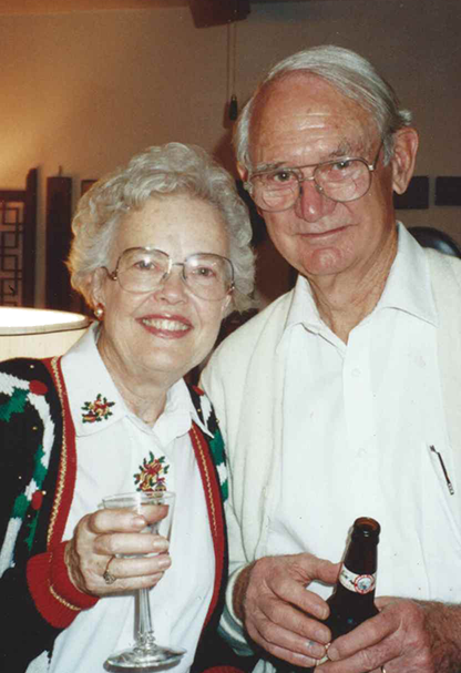 A smiling older couple.