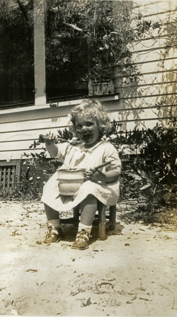 A little boy that is sitting on a bench