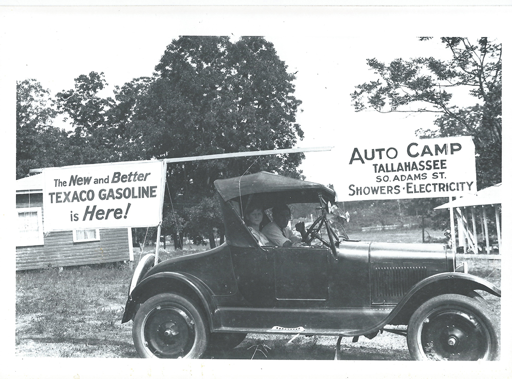 Vintage photo of Model A Ford automobile parked in front of Chandler's first business.