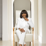 Patti LaBelle standing in front of a building