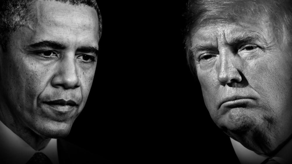 Black and white photo of Obama and Trump's faces.