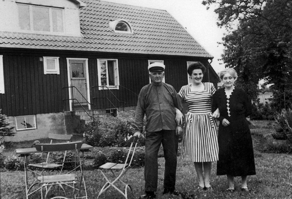 Black and white photo of three people