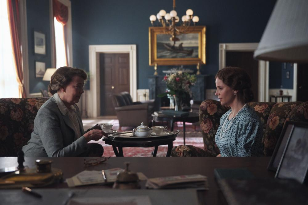 Two women at a coffee table