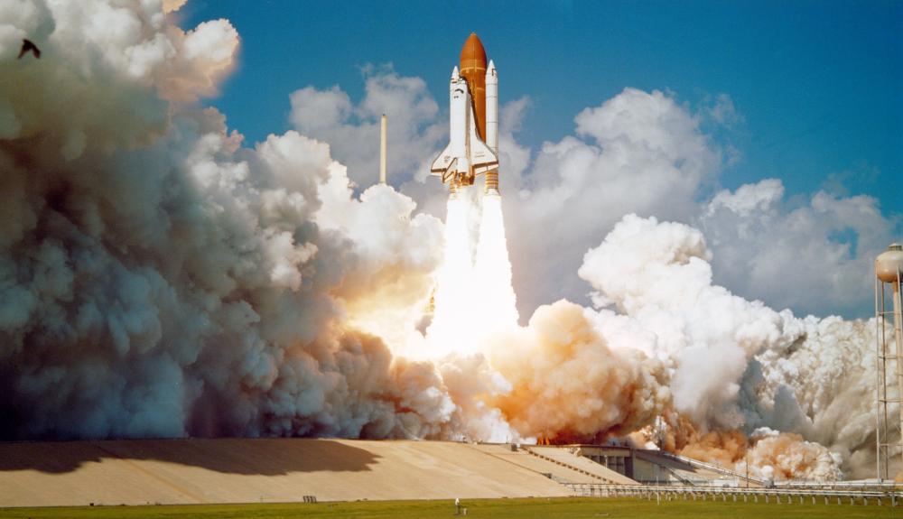 Space shuttle challenger blasting off