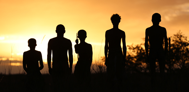 Silhouette of a human family infront of the sunrise