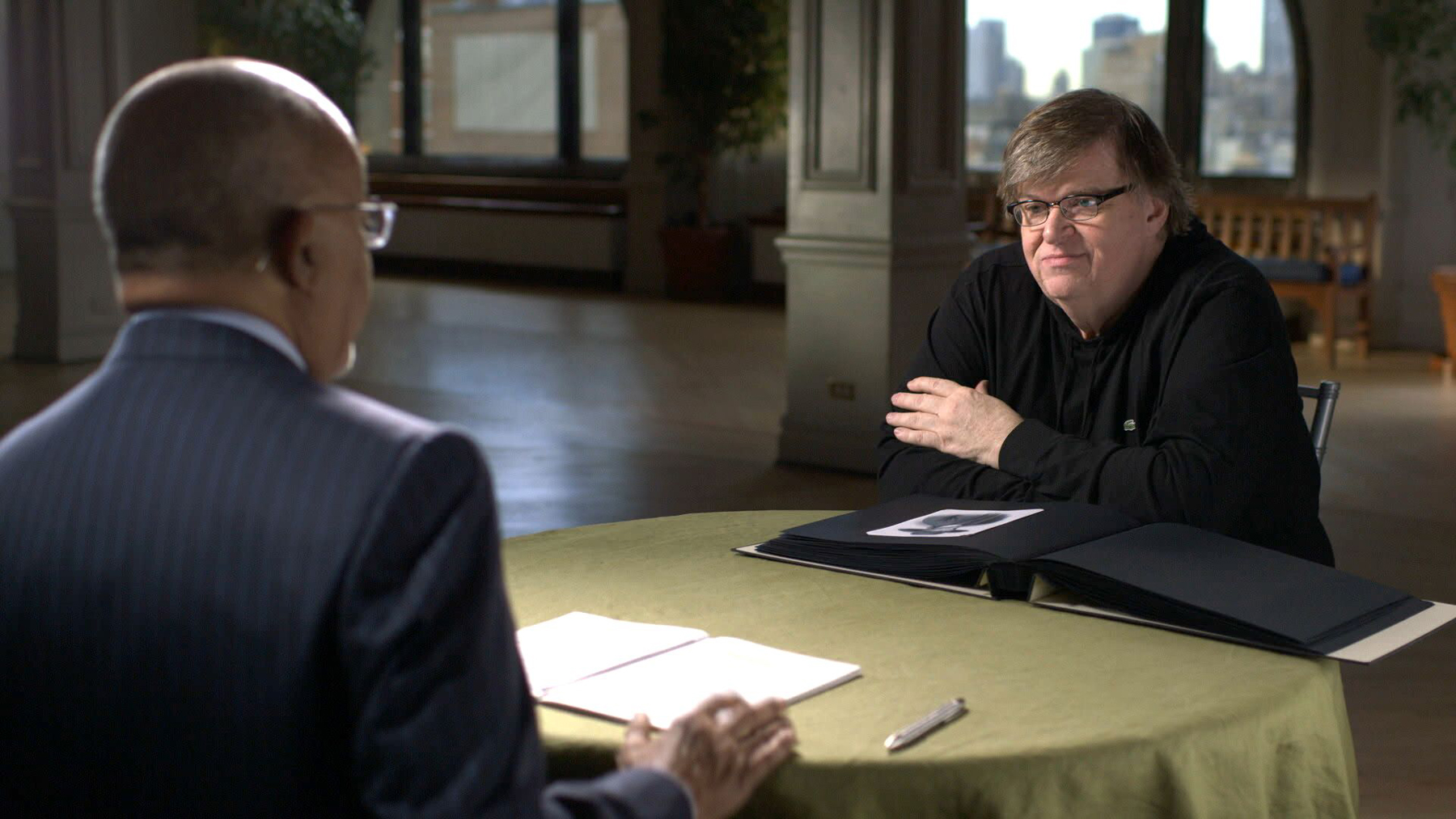 Host Henry Louis Gates, Jr. and Michael Moore