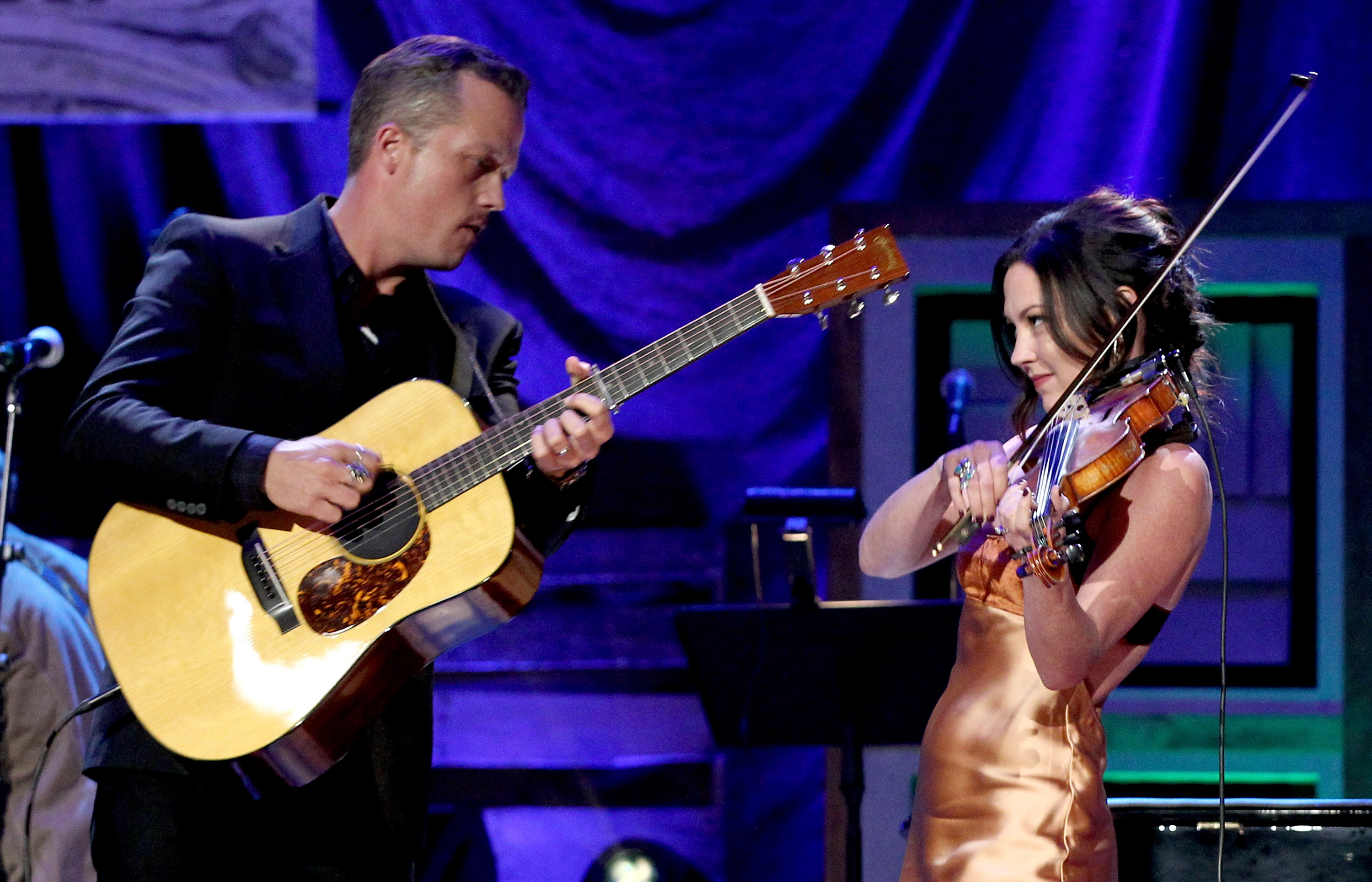 Jason with guitar and Amanda with violin performing