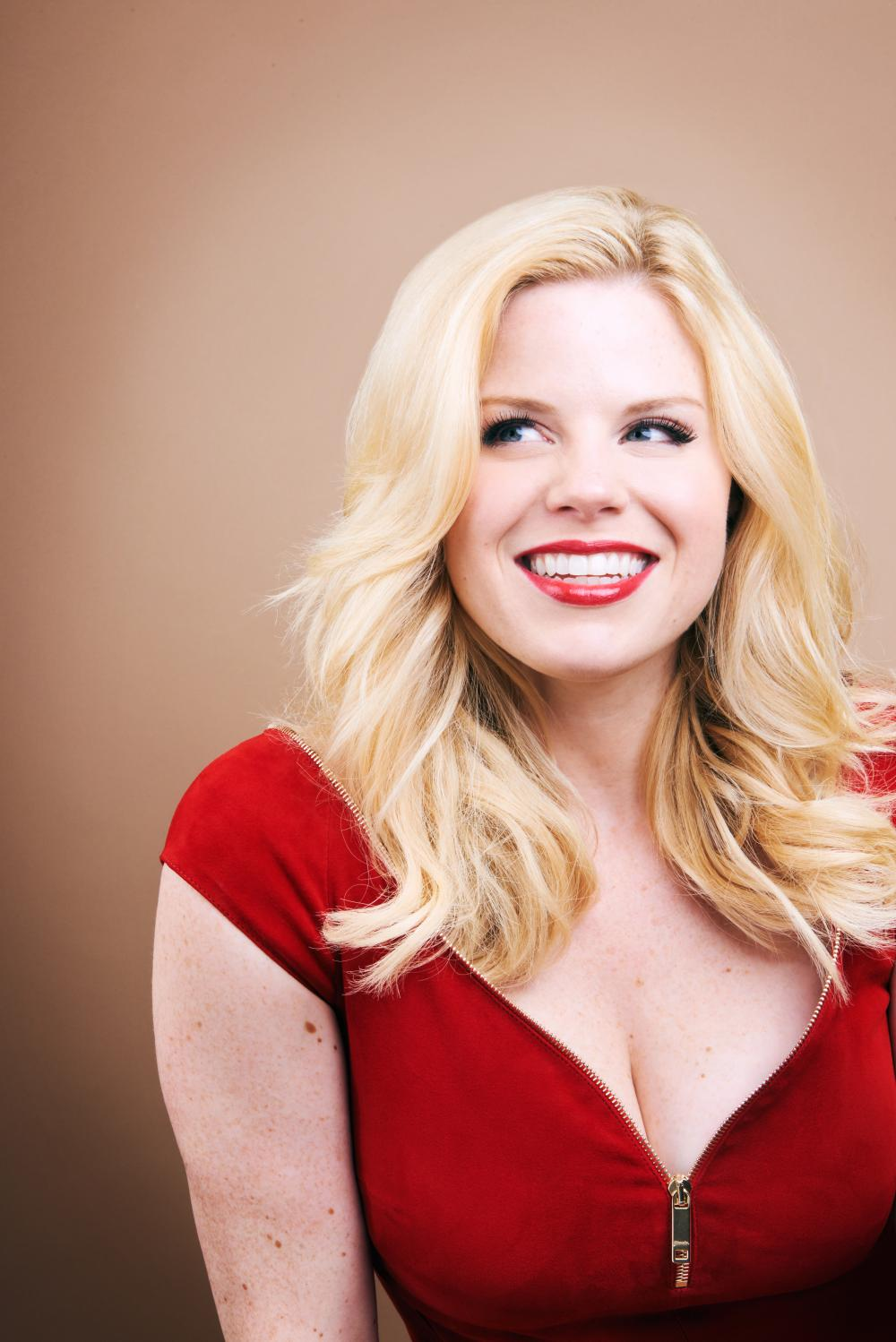 Megan Hilty in a red shirt