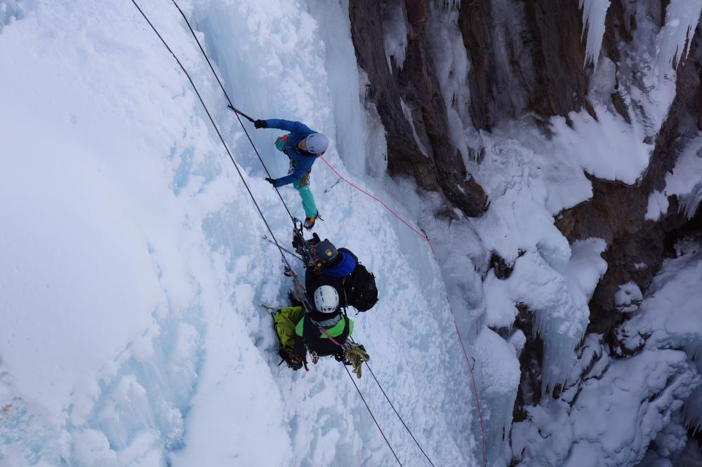People ice climbing