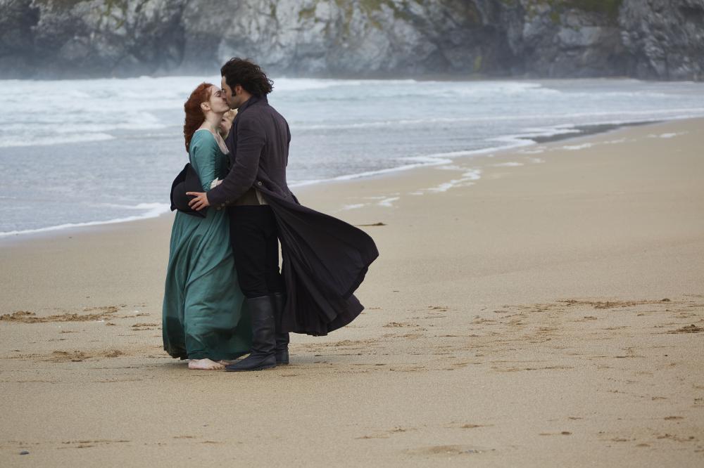Poldark kissing his lover on a beach