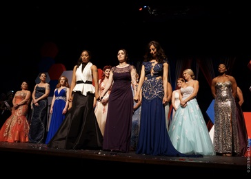 women in gowns on stage