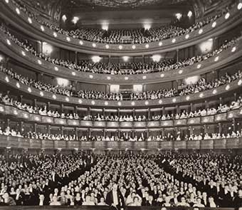 view of the packed audience from the stage of the opera house