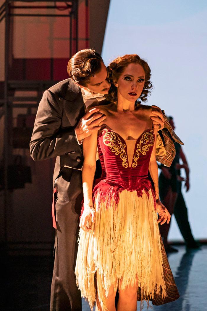 a  standing man bent over a standing women in a dance dress