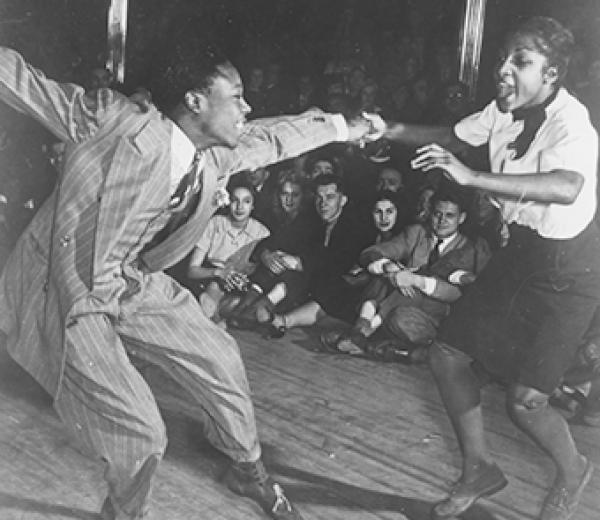 black and white photo of a couple dancing to early jazz