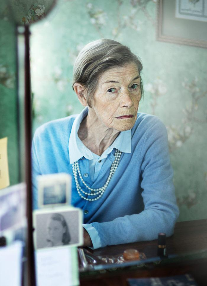 older woman in a blue sweater