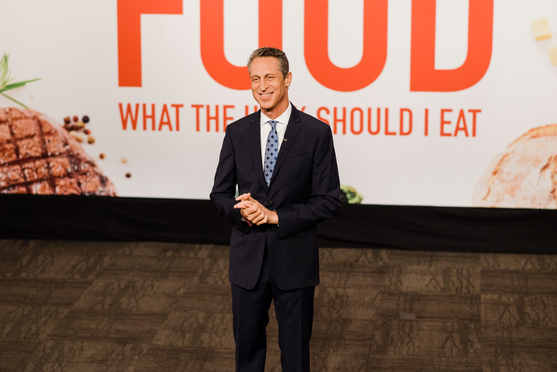 Mark Hyman, MD in front of the Food logo