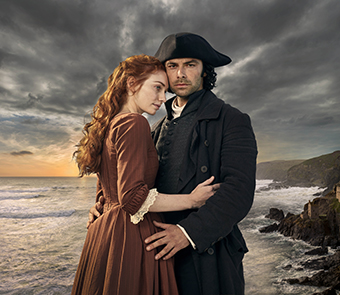 poldark standing with woman in front of water