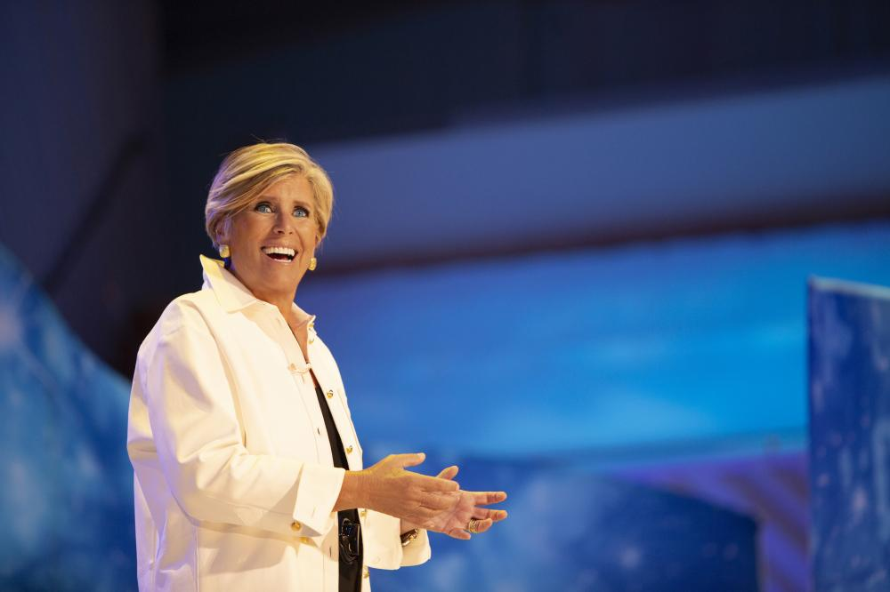 suze orman in a white jacket