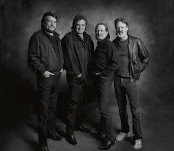 black and white photo of 4 members of the band from head to toe
